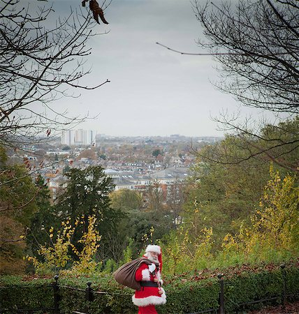 Santa Claus carrying sack over shoulder Stock Photo - Premium Royalty-Free, Code: 649-07520223