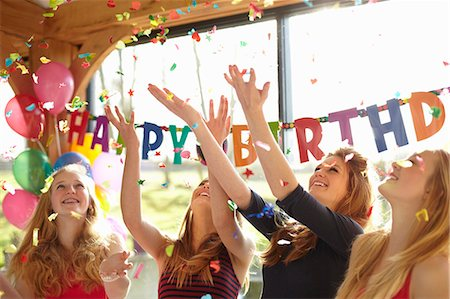 event - Four teenage girls celebrating with confetti at birthday party Stock Photo - Premium Royalty-Free, Code: 649-07520277