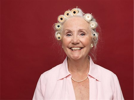 Studio portrait of senior woman in hair rollers Stock Photo - Premium Royalty-Free, Code: 649-07520300