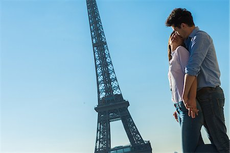 Young couple embracing near Eiffel Tower, Paris, France Stock Photo - Premium Royalty-Free, Code: 649-07520326