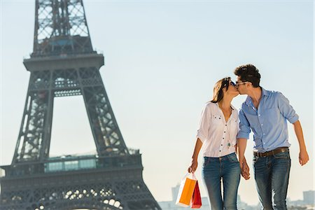 Young couple kissing near Eiffel Tower, Paris, France Stock Photo - Premium Royalty-Free, Code: 649-07520327
