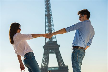 Young couple in front of  Eiffel Tower, Paris, France Stock Photo - Premium Royalty-Free, Code: 649-07520328