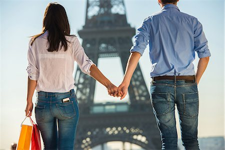 Young couple strolling in front of  Eiffel Tower, Paris, France Stock Photo - Premium Royalty-Free, Code: 649-07520329