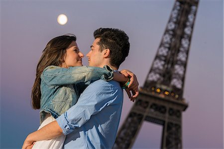 Young couple embracing in moonlight, Paris, France Stock Photo - Premium Royalty-Free, Code: 649-07520322