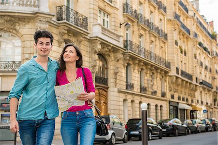 Young couple with map, Paris, France Stock Photo - Premium Royalty-Free, Code: 649-07520335