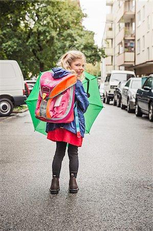 Young schoolgirl carrying umbrella Stock Photo - Premium Royalty-Free, Code: 649-07520337