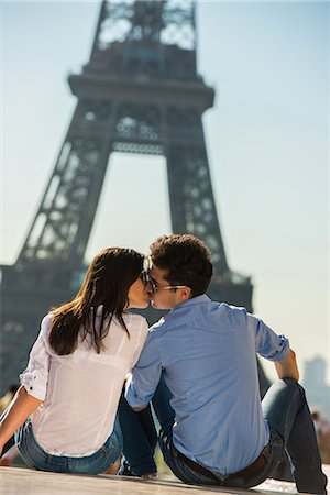 Young couple kissing in front of  Eiffel Tower, Paris, France Stock Photo - Premium Royalty-Free, Code: 649-07520330