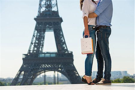 Young couple embracing in front of  Eiffel Tower, Paris, France Stock Photo - Premium Royalty-Free, Code: 649-07520331