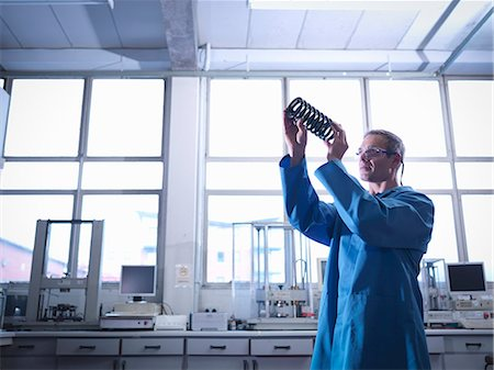 people working in factory - Worker inspecting spring in laboratory Stock Photo - Premium Royalty-Free, Code: 649-07520392