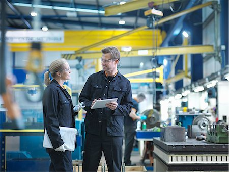people working in factory - Workers in discussion in engineering factory Stock Photo - Premium Royalty-Free, Code: 649-07520473