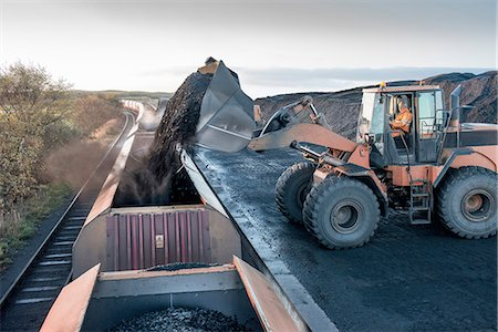 people working coal mines - Diggers loading coal onto train at surface coal mine at dawn Stock Photo - Premium Royalty-Free, Code: 649-07520488