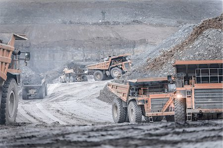 people working coal mines - Dumper trucks in surface coal mine Stock Photo - Premium Royalty-Free, Code: 649-07520519