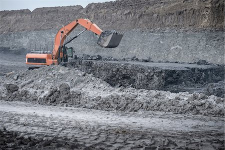 people working coal mines - Large digger and geological strata in surface coal mine Stock Photo - Premium Royalty-Free, Code: 649-07520525
