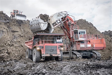 Large excavator and dumper truck in surface coal mine Stock Photo - Premium Royalty-Free, Code: 649-07520520