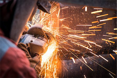 Metal grinding in repair works in surface coal mine Stock Photo - Premium Royalty-Free, Code: 649-07520522