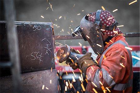 Metal grinding in repair works in surface coal mine Stock Photo - Premium Royalty-Free, Code: 649-07520523