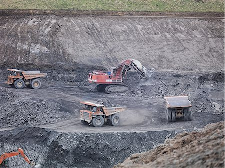people working coal mines - Diggers and dumper trucks at work in surface coal mine Stock Photo - Premium Royalty-Free, Code: 649-07520533