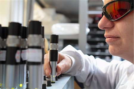 science & technology - Young female scientist experimenting in laser laboratory Stock Photo - Premium Royalty-Free, Code: 649-07520617