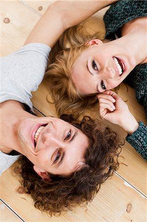 Studio shot couple lying on floor Stock Photo - Premium Royalty-Free, Code: 649-07520623