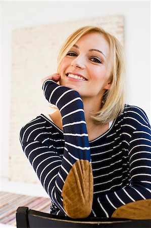 Studio portrait of young woman in stripes Stock Photo - Premium Royalty-Free, Code: 649-07520630