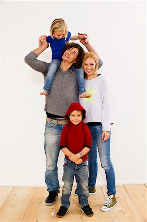 Studio portrait of couple together with son and daughter Stock Photo - Premium Royalty-Free, Code: 649-07520645