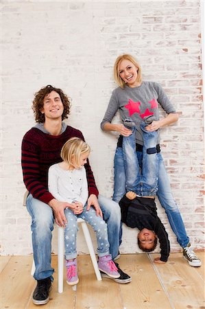 Studio portrait of couple waving fun with son and daughter Stock Photo - Premium Royalty-Free, Code: 649-07520647