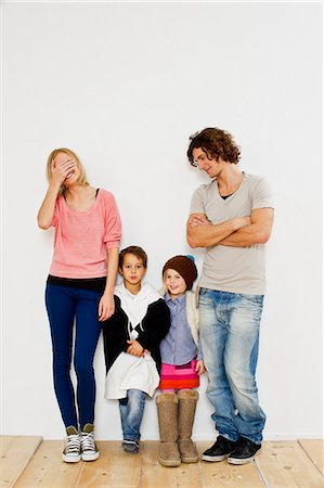 Studio shot of couple with son and daughter in oversize clothes Stock Photo - Premium Royalty-Free, Code: 649-07520654
