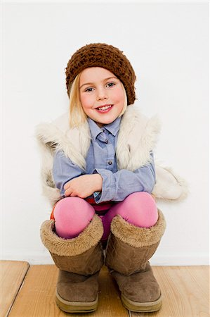 dress up girl - Studio portrait of young girl in oversize boots Stock Photo - Premium Royalty-Free, Code: 649-07520653