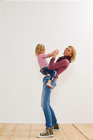 Studio portrait of mother playing with young daughter Stock Photo - Premium Royalty-Free, Code: 649-07520667