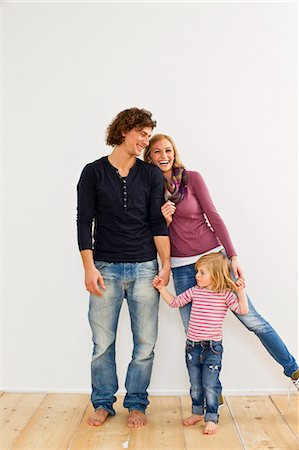 Studio shot of couple holding hands with young daughter Stock Photo - Premium Royalty-Free, Code: 649-07520669