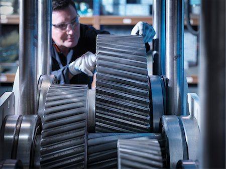 Engineer working on industrial gearbox Stock Photo - Premium Royalty-Free, Code: 649-07520709