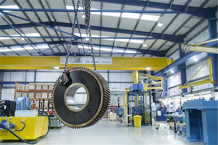 Heavy engineering gear hanging from crane in factory Stock Photo - Premium Royalty-Free, Code: 649-07520722