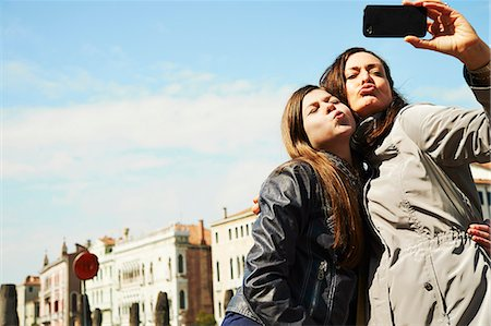 pucker - Mother and daughter taking selfie on smartphone, Venice, Italy Stock Photo - Premium Royalty-Free, Code: 649-07520748