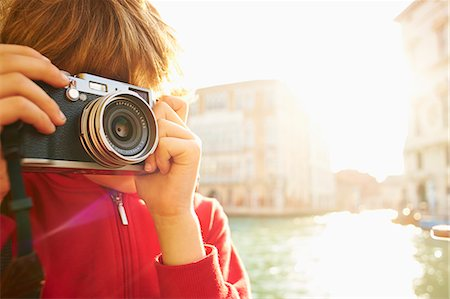 european (places and things) - Young boy exploring with camera, Venice, Italy Stock Photo - Premium Royalty-Free, Code: 649-07520755