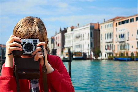 discovery - Young boy taking photographs, Venice, Italy Stock Photo - Premium Royalty-Free, Code: 649-07520751
