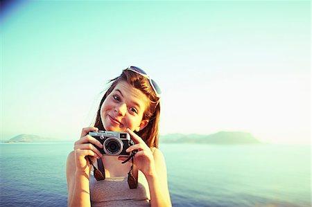 Portrait of girl holding camera on holiday, Kas, Turkey Stock Photo - Premium Royalty-Free, Code: 649-07520775