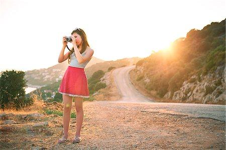 Girl taking photographs at sunset, Kas, Turkey Stock Photo - Premium Royalty-Free, Code: 649-07520778