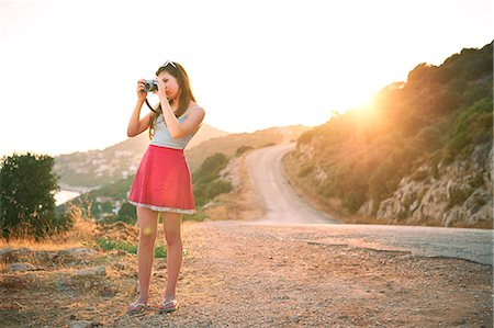 Girl taking photographs at sunset, Kas, Turkey Stock Photo - Premium Royalty-Free, Code: 649-07520778