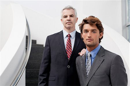 Portrait of two businessmen on office stairs Stock Photo - Premium Royalty-Free, Code: 649-07520779