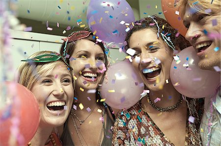 Young adult friends celebrating at party Stock Photo - Premium Royalty-Free, Code: 649-07520842