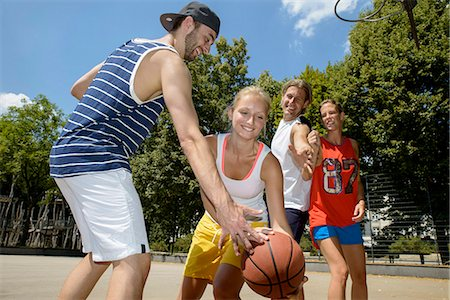Group of friends playing basketball in park Stock Photo - Premium Royalty-Free, Code: 649-07520881