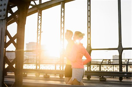 fit people - Young male and female running on bridge Stock Photo - Premium Royalty-Free, Code: 649-07520925