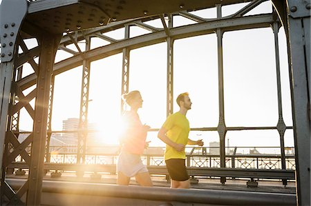 sports - Young male and female running across bridge Stock Photo - Premium Royalty-Free, Code: 649-07520926