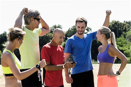 five - Mature trainer celebrating timing with group of adults Stock Photo - Premium Royalty-Free, Code: 649-07520937