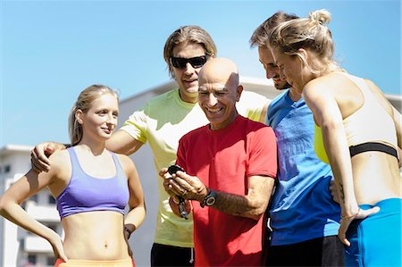 stop watch - Mature male trainer and a group of adult runners Stock Photo - Premium Royalty-Free, Code: 649-07520940