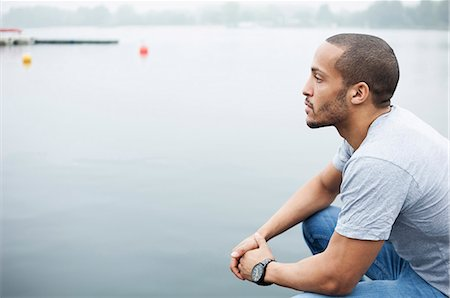 portrait looking away - Portrait of young man by lake Stock Photo - Premium Royalty-Free, Code: 649-07520943