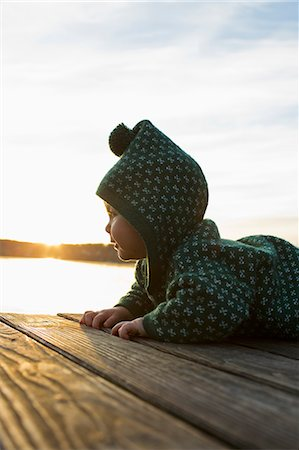 Baby girl crawling on jetty Stock Photo - Premium Royalty-Free, Code: 649-07520967