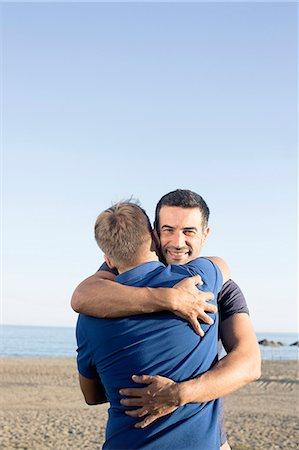 Mature male couple hugging on beach Stock Photo - Premium Royalty-Free, Code: 649-07521039