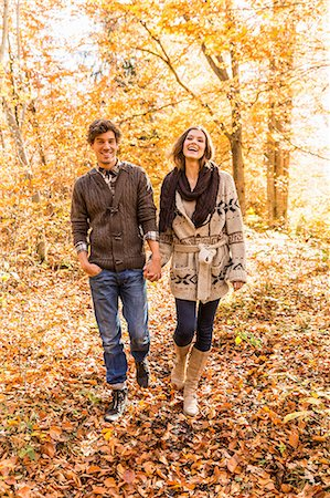 fall - Couple walking in forest holding hands Stock Photo - Premium Royalty-Free, Code: 649-07521099