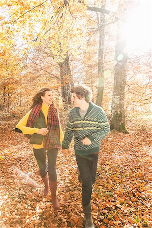 Couple running in forest holding hands Stock Photo - Premium Royalty-Free, Code: 649-07521103